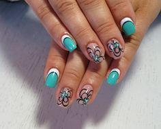 Flowers are the best when it comes to summer nail art designs. Decorate your nails with pretty flowers and amazing color combinations such as blue green, white, black and nude polish. The result is simply beautiful.