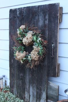 old barn door used for outside decoration hanging watering can