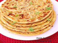 These warm and aromatic spicy parathas are a delight! By adding some different herbs and spices to my regular parathas dough recipe, one can get some super flavourful results to break the monotony of having plain parathas every time. I normally enjoy these hot with a simple cup of tea but they also work well with a pickle or curry. You can add or play around with different spices and herbs to find something that you personally enjoy.
