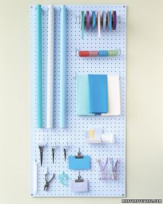 DIY peg board for gift wrapping supplies; This article has a lot of good tips on gift wrapping..thanks Martha!