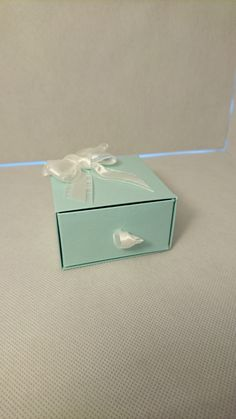 """Gift box with pull out drawer. Made from quality card stock. The sides of drawer and outside are double layered for a professional look and extra support.   Measures approx 3"""" wide and depth 1.5""""in height   Finished off with white organza triple bow.   Can be made in different colours     I have shown a bracelet in the box which is available separately 