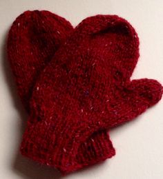 Jolly red mittens for a toddler, hand knitted in Rowan Felted Tweed