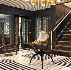 Designer Kelly Wearstler makes an entrance with striped tiles that match the ceiling.