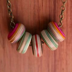 Skateboard Jewellery made by Sam Messina, using broken skateboard decks. Amazing colours, beautiful light piece to wear.