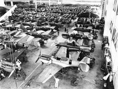 Curtiss P-40 Warhawk fighter aircraft being manufactured, likely in Buffalo, New York, ca 1939. (Editor's note, the AP caption for this phot...
