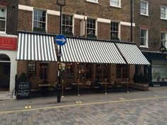 Three wonderful Victorian Shop Blinds at the Grazing Goat by Deans Blinds And Awnings