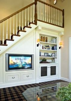 There are lots of methods to create under stair storage space. I really like the manner that this under stair storage space stipulates a desk area for those kids. Living Room Under Stairs, Space Under Stairs, Staircase For Small Spaces, Space Saving Staircase, Living Rooms, Staircase Storage, Staircase Design, Staircase Ideas, Stair Design