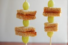 Sticking with PB& J - Alternate pieces of sandwich and grapes on a stick. For more creative ideas for kids lunches LIKE US on Facebook @ https://www.facebook.com/SchoolLunchIdeas