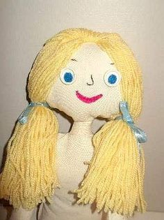 How to Make a Doll from fabric with loose woolen hair and button eyes. This craft is for older chilren from 10 to teen years who are learning creative sewing.