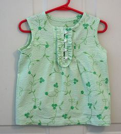 The Little Summer Top is an easy sewing pattern great for little girls to wear when the weather is warm and sunny.