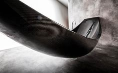 """An awesome bathtub with a sleek and futuristic design, which seems to lightly float off of the ground as an hammock made of carbon fiber with amazing curves. """"Vessel"""" is an incredible bathtub designed by the British design studio Splinter Works (Miles Hartwell and Matt Withington)."""