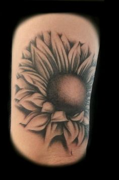 Sunflower tattoo. Love the angle of this. Next tattoo is a sunflower.