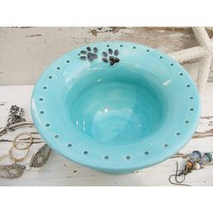 Earring holder paw prints jewelry dish pet dog ceramic jewelry bowl aqua green blue handmade ($26) found on Polyvore