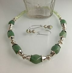 Aventurine carved stone beads, crackle beads, pewter with SS overlay, magnetic clasp.