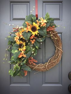 Sunflower Wreath, Spring Sunflowers, Spring Door Wreaths, Sunflower Decor, Spring Gifts, Gift for Her, Sunflower Decorations, Spring Door If you like sunflowers then this wreath is calling your name! Three lovely faux sunflowers decorate the left side of this wreath with very natural looking leaves, some berries and a few added flowers for another pop of color that come together to make a classic spring design suitable for almost any home. Measures 22 x 27 inches but built on and 18 inch…