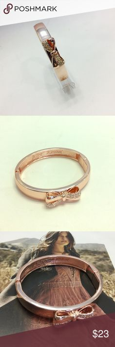 """Betsey Johnson Rose Gold & Crystal Bow Bangle Delicate Pave' Sparkles adds feminine edge to this charming bow hinged bangle created by Betsey Johnson in rose-gold tone mixed metal. Approximately 2 1/4"""" diameter Betsey Johnson Jewelry Bracelets"""
