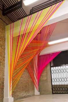 string art inspired altar detail in neon - Modern weddings in neon palettes look so electric in the summer. These colors pop with a white background or in the bright sunshine, so consider this scheme to create a fun vibe for a loft or beach wedding.  Especially if you want your wedding to feel less like a formal event and more like the most epic party of the year, searingly bright neons are definitely the way to go.