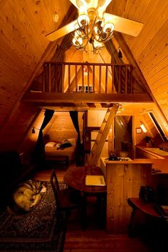 A-Frame cabin interior - one thing I can say for the A-Frame is the tall interior gives a feeling of space. This is cute!