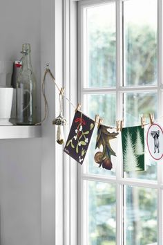 Hanging Display.......... love this, would look great in front of a window, door or mantel...