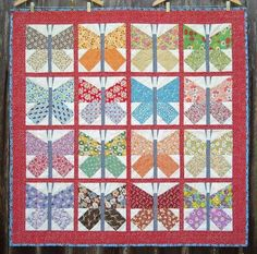 Butterfly quilt for baby made from feed sack material. Vintage fabric is preferrable, but reproduction prints okay.