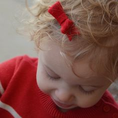 How cute are miss Kate's curls? Our red mini bow clip is a great addition to those lovely locks! So adorable! Shop Kate's look today