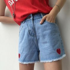 high waisted denim shorts, with frayed hems, and two embroidered red hearts, 90s themed outfits, worn with a red shirt, tucked into them