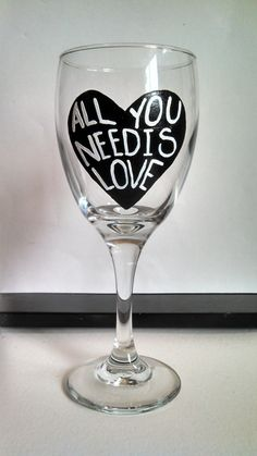 All you need is Love hand painted wine glass on Etsy, $20.00