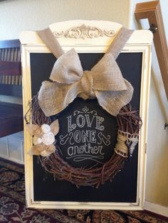Old mirror, chalk painted with burlap embellished wreath