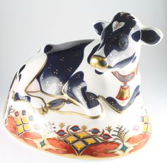 """Lot 151, A Royal Crown Derby Japan pattern paperweight in the form of as Friesian Cow """"Buttercup"""" with gold stopper, boxed 6 1/2"""" est £50-75"""