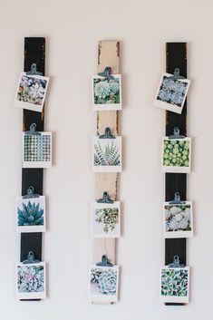 simple boards and metal clips photos display (via Design Sponge)