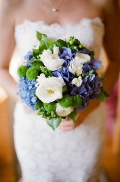 Ranunculus,hydrangea,freesia and kermit poms. Super cute.