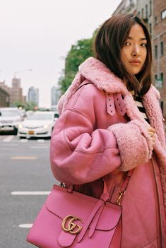 Hannah Park in her own pink shearling coat and Gucci GG Marmont top-handle bag