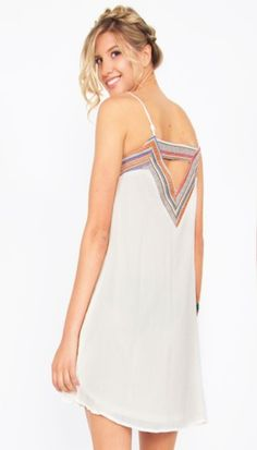 60ebee13235852 Mojave Dress*This cream shift spaghetti strap dress with an ethnic trim in  the front