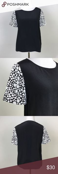 "[Madewell] Sequin Sleeve Silk Top Black Blouse XS Clusters of sequin shapes on the sleeves gives this tee the look and feel of a vintage treasure. Pullover style. Crew neck. 100% Silk.  🔹Pit to Pit: 17"" 🔹Length: 22"" 🔹Condition: Excellent pre-owned condition.  *V55 Madewell Tops Blouses"
