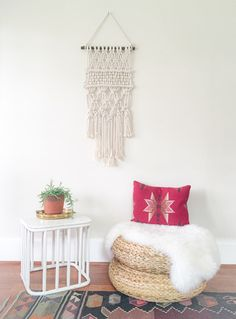 This beautiful macrame wall hanging brings together traditional knotting and weaving to create a modern take on a vintage form of fiber art.  Knotted onto a wooden dowel.  Great for any space large...