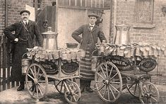 Milk delivery hand carts with jugs and milk churns - with the dairy owner John Jones and his assistant, early 1900s.