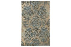 Whether you favor traditional or contemporary furnishings, this wonderfully versatile accent rug is sure to look right at home. Brilliant blue medallions are romanced with a touch of distressing for a look of faded elegance. Thick and sumptuously soft, the all-wool pile is plenty pleasing.