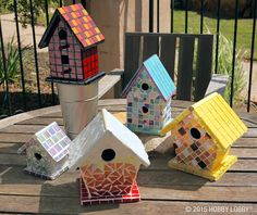 Mosaic birdhouses add a classy touch to any backyard decor.