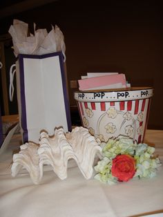This couple had an awesome boardwalk theme, so we incorporated the popcorn bucket for the cards