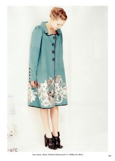 Love the pale aqua blue coat with black buttons and embellishments