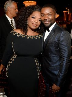 Pin for Later: Go Inside the Star-Studded Golden Globes  Oprah Winfrey cozied up to her Selma costar David Oyelowo.