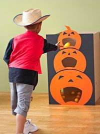 ping pong ball toss - 3 levels - score like ladder ball - need a box, orange and black poster board, spray adhesive,  and yee ha! Frugal Halloween Party,halloween party,#halloween