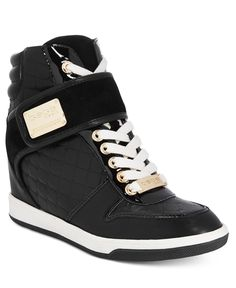 Glamorous street-chic style. bebe Sport Colby sneakers feature shimmering…