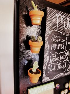 DIY Cactus refrigerator magnets with tiny terracotta pots from #Michaels. So cute. So easy. And such a great gift idea!