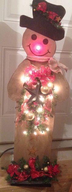 Primitive 4' snowman dressed for Christmas.