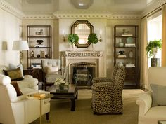 """James Michael Howard   ...""""The symmetry and balance of this room are offset by the playfulness of the leopard chairs."""""""