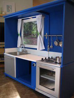 Entertainment center into a play kitchen