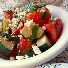 Tomato, Basil, and Feta Salad Allrecipes.com....made for a party.  added clove of garlic, used cherry tomatoes, used basil paste instead of fresh. GOOD STUFF!