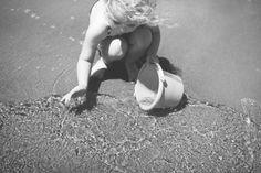 Child at the beach by Melaniea85