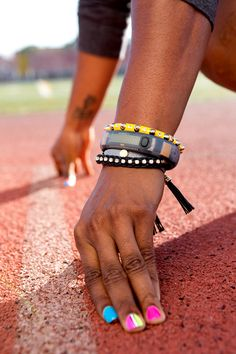 Shelly-Ann shows off her  armparty at the track.  nike  fuelband fd677683f2